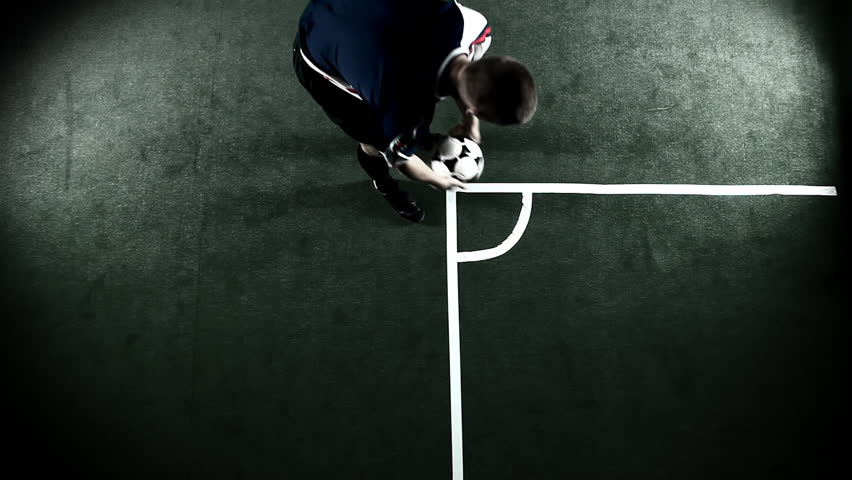 Soccer player does a corner kick. Wide shot birds eye view - HD stock footage clip
