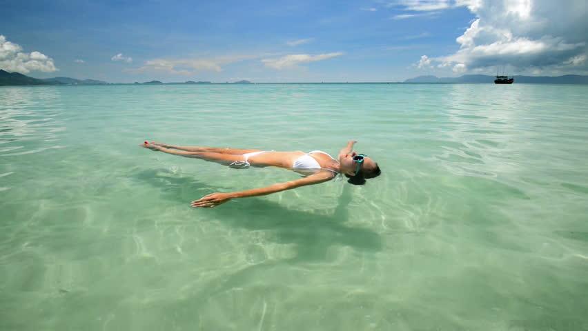Woman in bikini floating on the sea. Philippines
