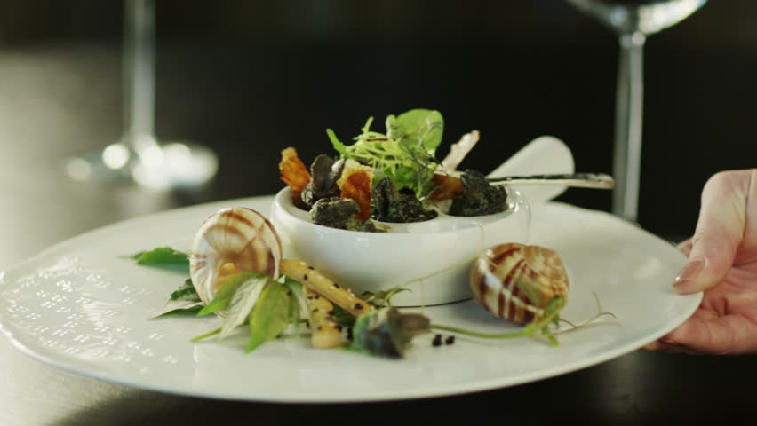 Serving Delicious Baked Escargots in Luxury Restaurant. Close-Up. Shot on RED Digital Cinema Camera in 4K (ultra-high definition (UHD), so you can easily crop, rotate and zoom, without losing quality.