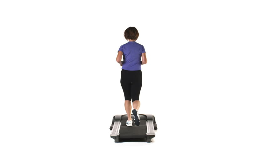 Wide shot of an older woman running on a treadmill, on a white background - HD stock video clip