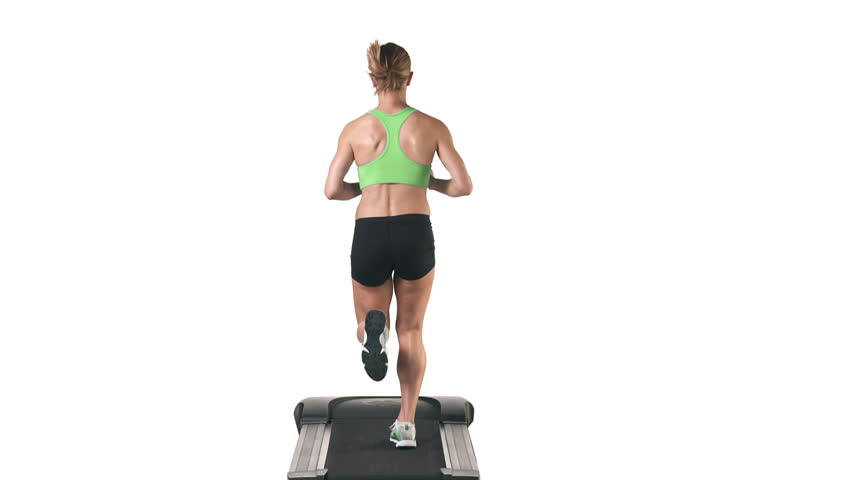 Wide shot of a female running in place on a treadmill, while looking into the camera on a white background - HD stock footage clip