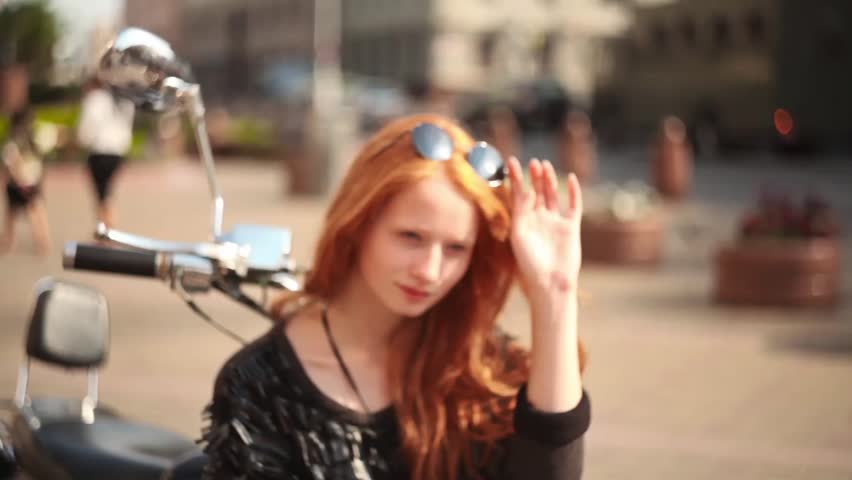 Cute girl with red hair and the old motorbike - HD stock footage clip