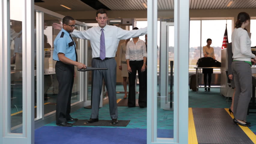 Airport security guard stands watch at metal detector stock footage video 4653620 shutterstock - Security guard hd images ...