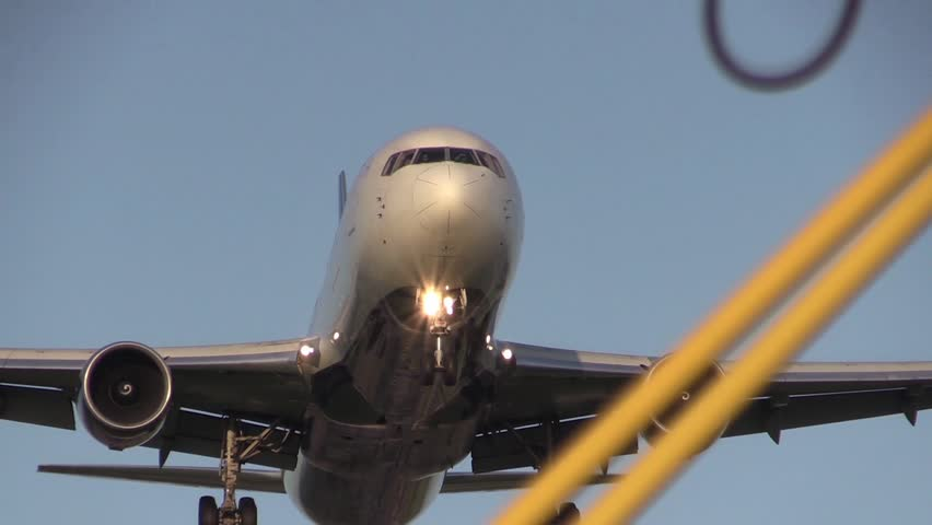 Big airplane flying overhead in the morning - HD stock footage clip