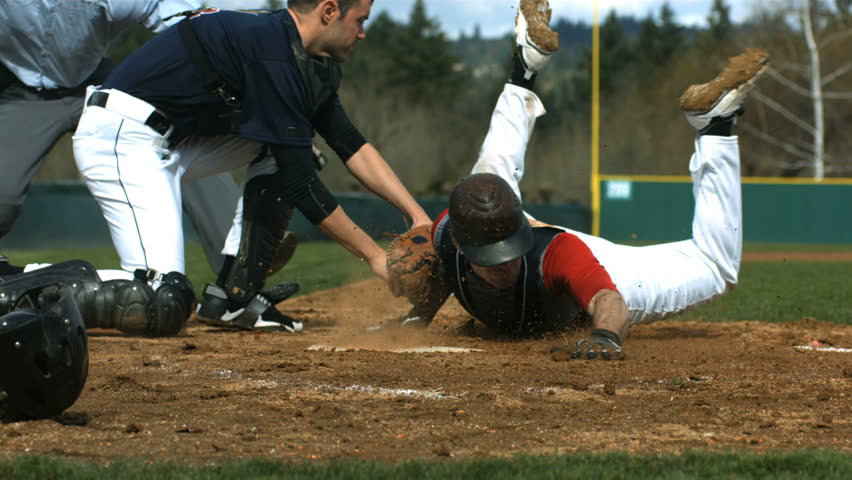 Baseball player slides into home plate, slow motion