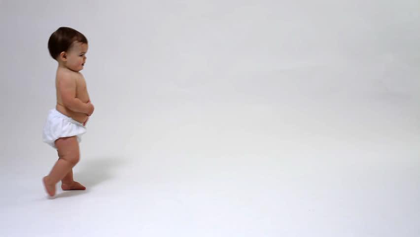 Toddler walking against white background #4634522