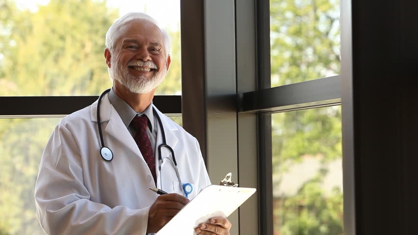 Portrait of doctor holding clipboard - HD stock footage clip