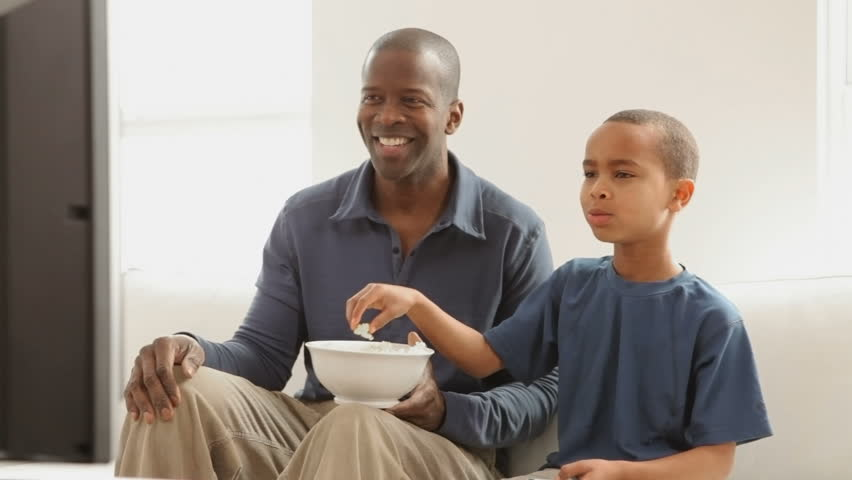 Father and son watching television together   Shutterstock HD Video #4649525