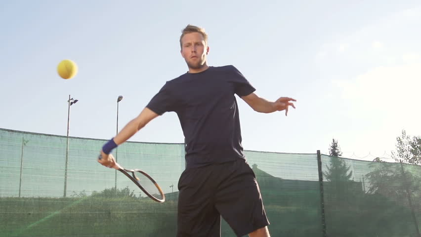 Slow Motion Shot Of A Professional Tennis Player Hitting Forehand With Tennis Racket On Clay Court | Shutterstock HD Video #4652837
