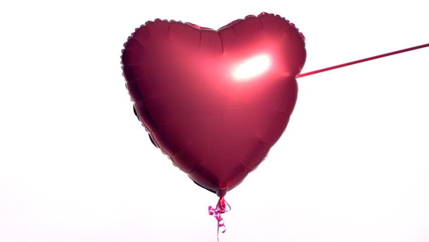 Valentine's Day balloon shot by arrow - HD stock video clip