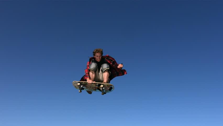 Skateboarder flying in air, slow motion