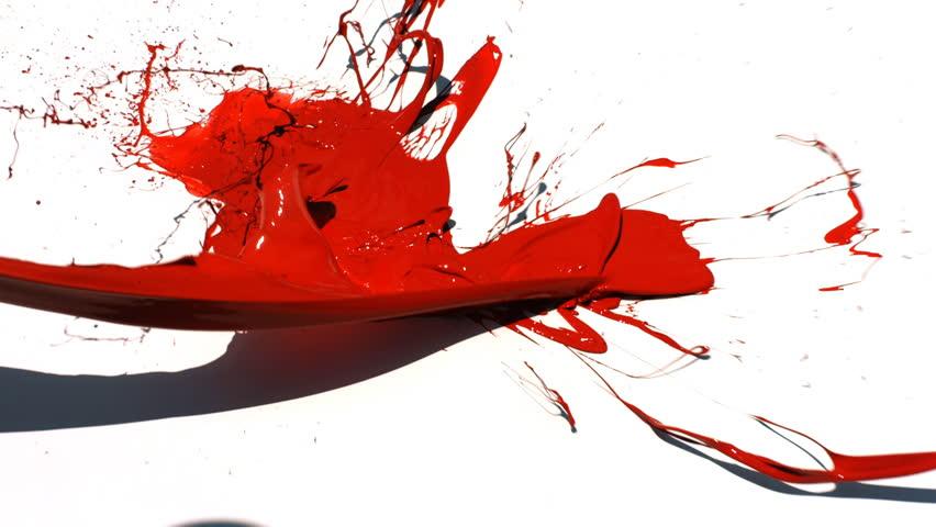 Red paint splattering on white background