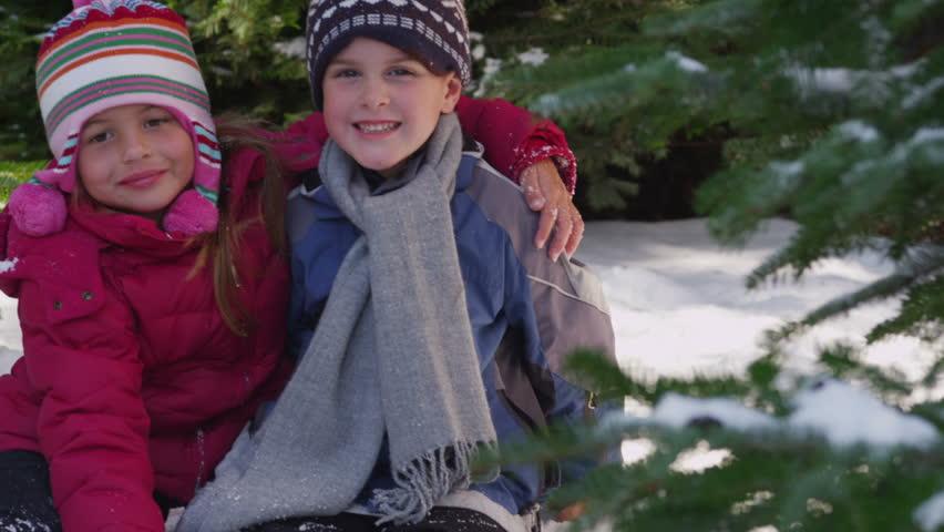 Portrait of two kids in winter - HD stock footage clip