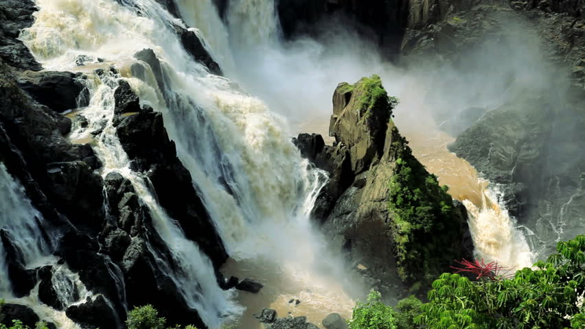 Majestic Barron Falls pours over a rocky cliff face in a forest preserve near Cairns, Queensland, Australia - HD stock video clip