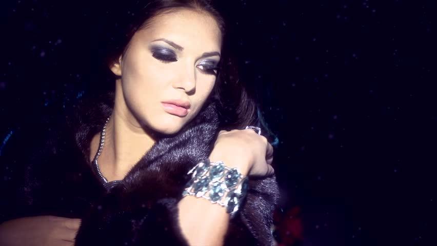 Beauty Fashion Model Girl in Mink Fur Coat. Beautiful Woman in Luxury Black Fur Jacket . Winter Fashion, Blowing Hair in the snow. Isolated.  | Shutterstock HD Video #4671836