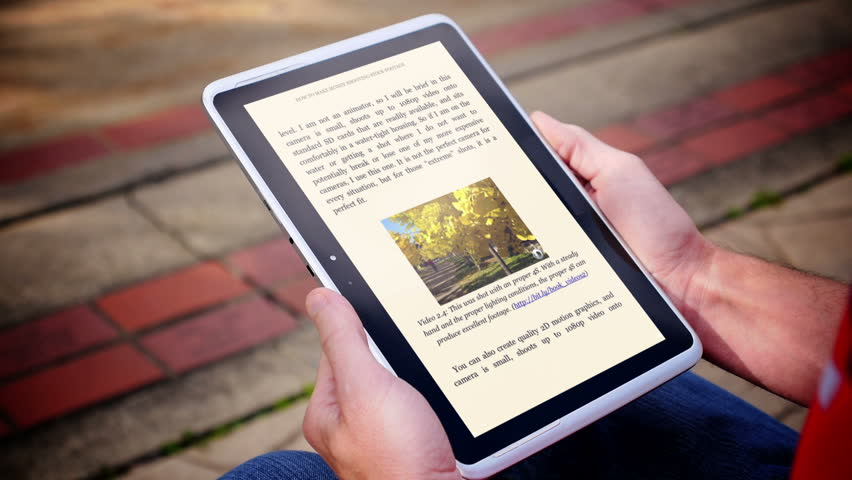 close up of a finger turning the pages of a digital ebook reader extreme shallow dof book. Black Bedroom Furniture Sets. Home Design Ideas