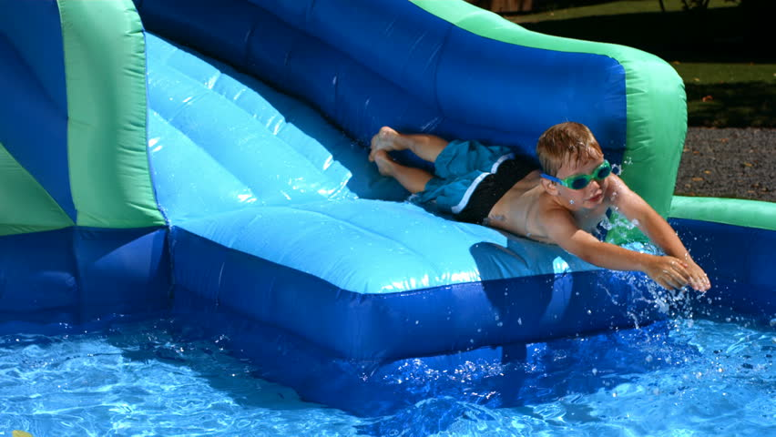 Young Boy Playing On Water Slide Stock Footage Video