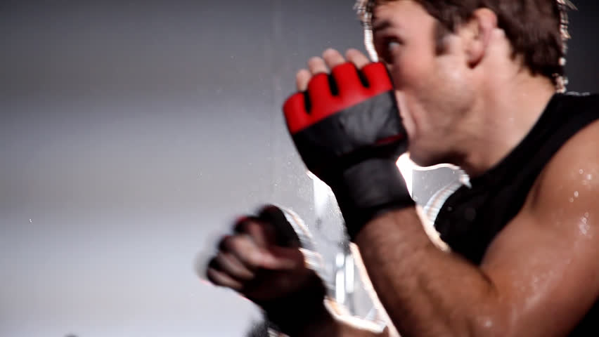 Mixed martial arts athlete trains with a boxing coach. Medium shot. - HD stock footage clip