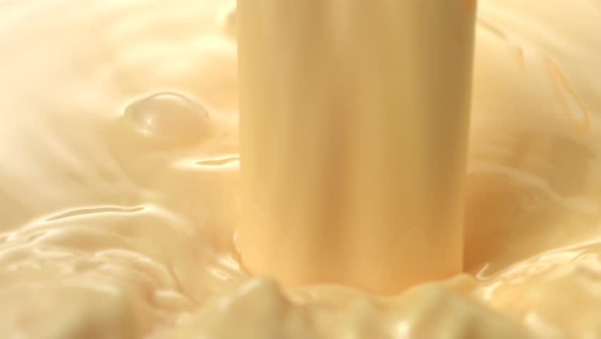 Vanilla Cream Pouring And Splashing, Slow Motion Stock ...