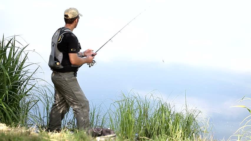 Sport fisherman fishing on a river   Shutterstock HD Video #4704479