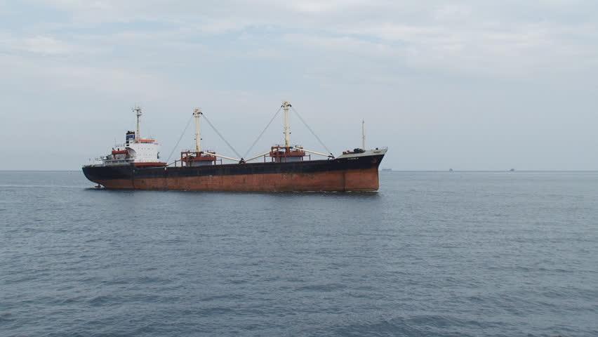 cargo ship on the high seas - HD stock video clip