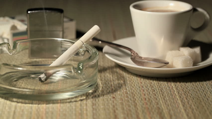Coffee, cigarettes and lighter. Dolly shot   Shutterstock HD Video #4721066