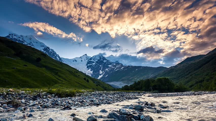 Time lapse clip. River in mountain valley at the foot of Tetnuldi glacier. Upper Svaneti, Georgia, Europe. Caucasus mountains. Beauty world. HD video (High Definition). #4725269