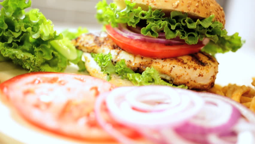 Close up of a freshly prepared grilled chicken sandwich with crunchy organic salad vegetables  #4745024