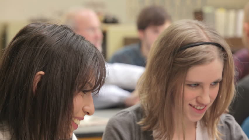 A group of college students work together to finish an assignment - HD stock footage clip