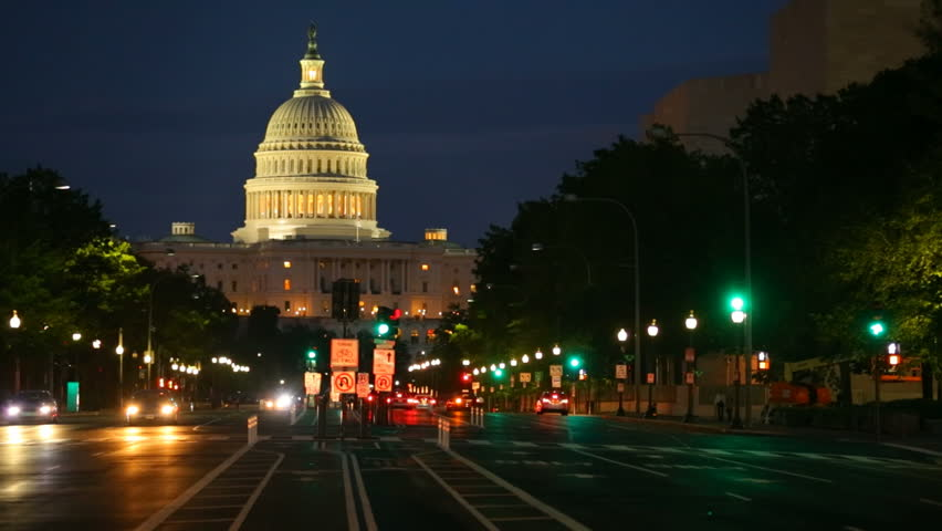 Timelapse shot of United States Capitol building night view from from Pennsylvania Avenue with car lights, Washington DC