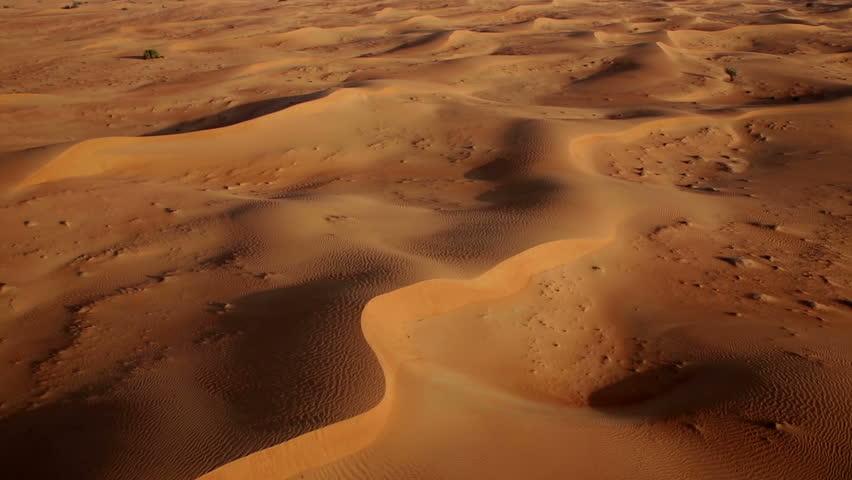 Aerial shot of sand dunes at sunrise, Arabian Dessert, Dubai, UAE