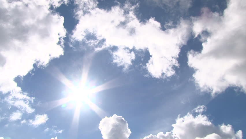 Time lapse of cloudscape with bright sun shining with clouds passing. #4751234