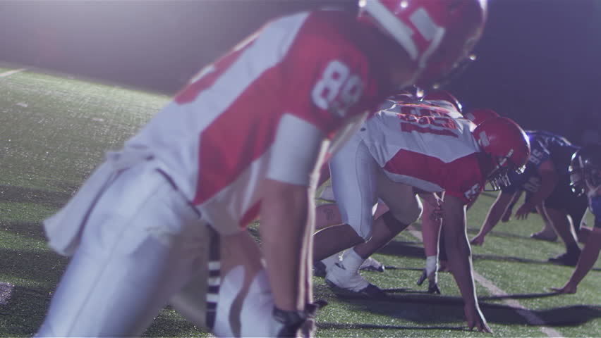Football players react to a hand off - HD stock video clip