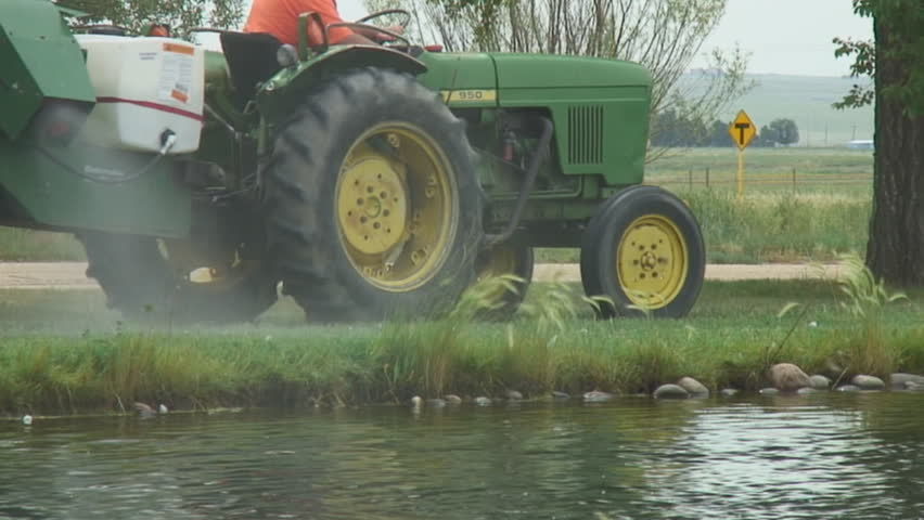 Misting device blows environmentally friendly pesticide mist along water's edge. - HD stock video clip