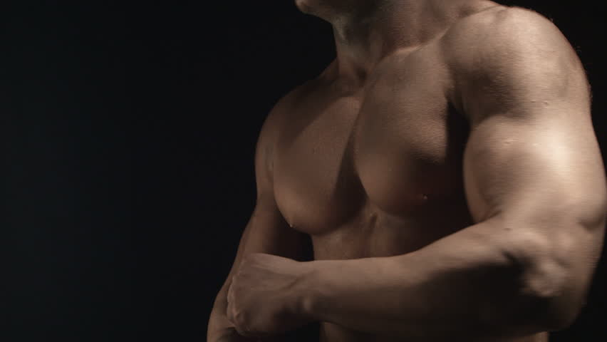 Muscular man in the lights slow motion