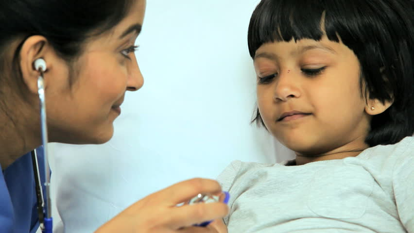 Close up view of a nurse using a stethoscope to listen to the heart rate of a very young female patient in the hospital | Shutterstock HD Video #4784624