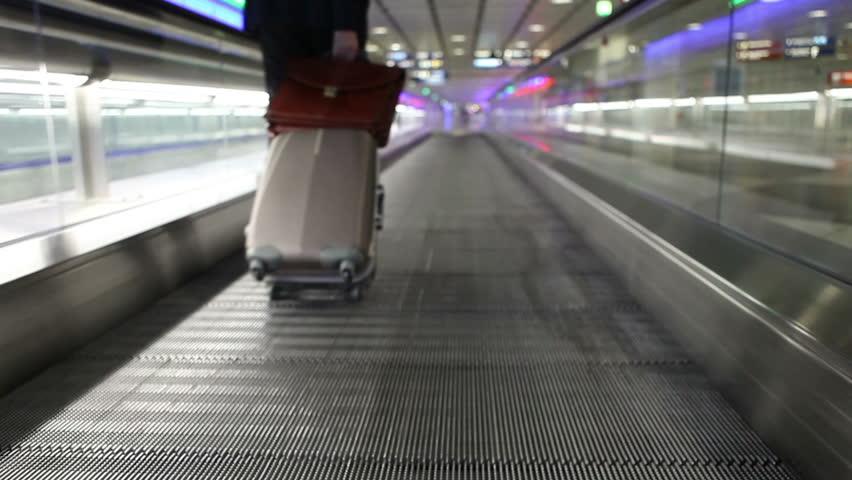 Airport walk way with passenger