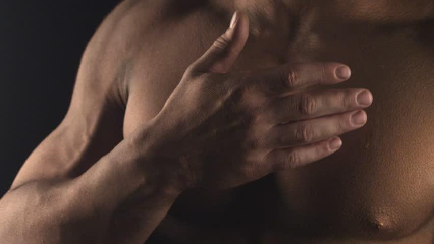 Water in hands of Muscular man