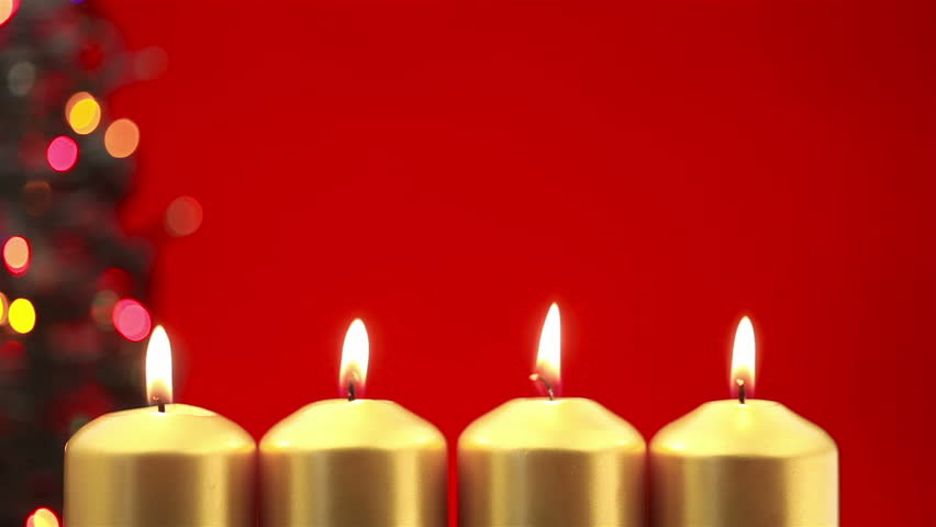 Blowing Out Four Christmas Candles After Advent On A Red