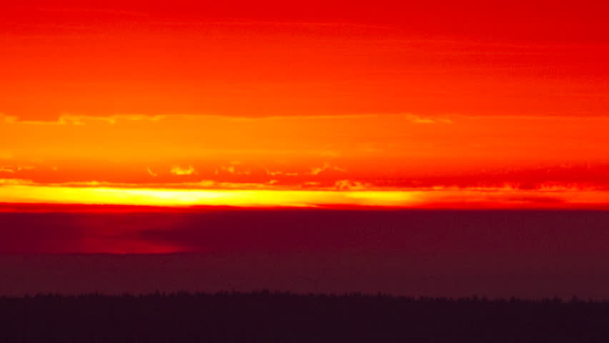 Fiery red sunrise under storm clouds during a rainstorm. Raindrops create a fake reflection effect.  - HD stock video clip