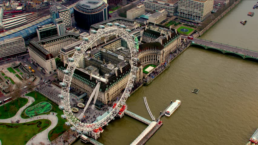 Aerial panorama of central London, UK. Features the River Thames, Millennium Wheel (London Eye), Waterloo and South Bank area.