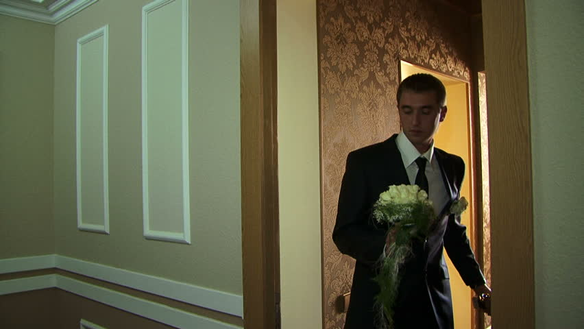 Groom leaving his hotel room for the ceremony.