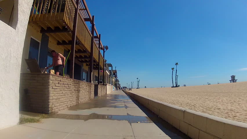 SEAL BEACH, CA: October 12, 2013- The camera is on the sidewalk rolling past