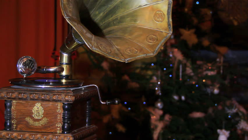Old gramophone playing vinyl disc, closeup.