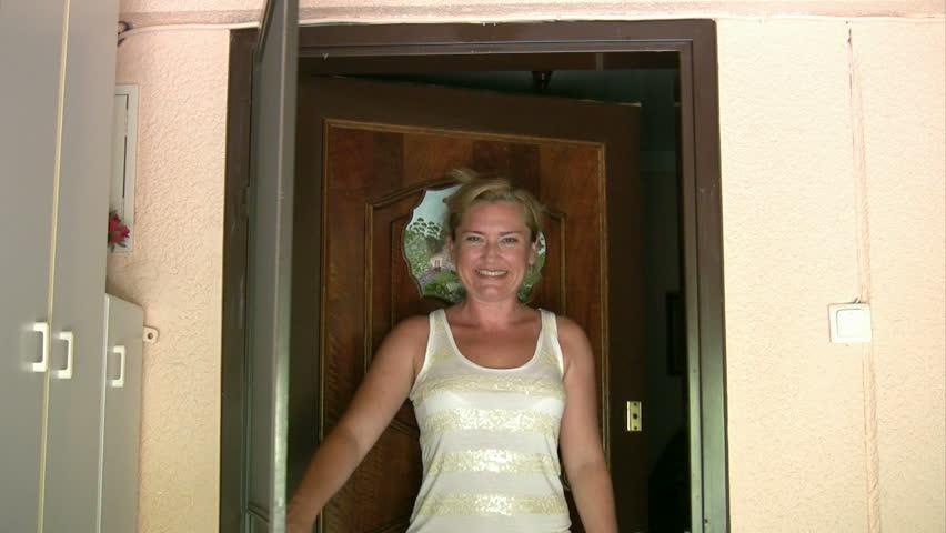 Women opening the door