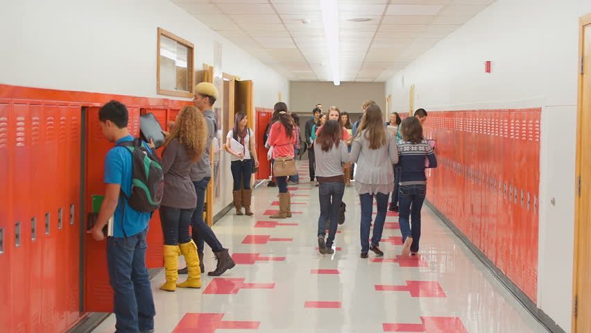 An empty school hallway fills up with students when the doors open at the end of the period | Shutterstock HD Video #4893605