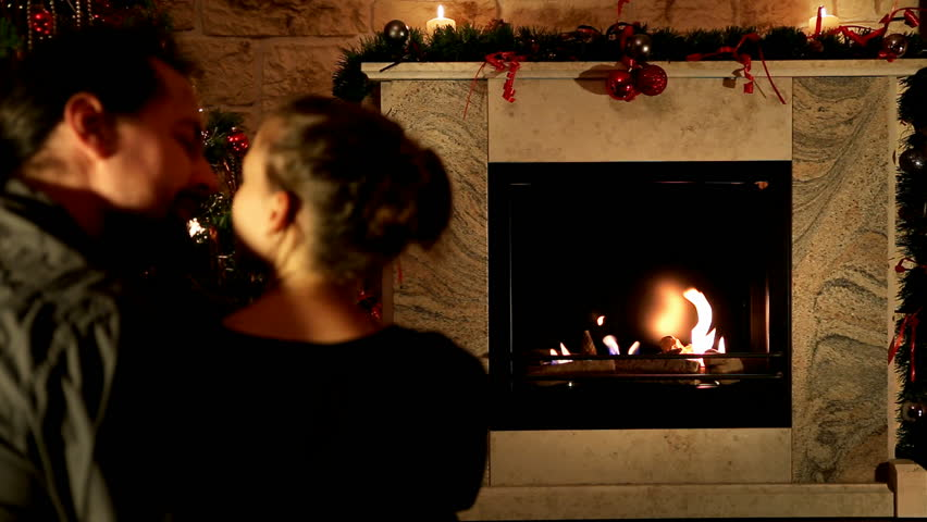 kiss in front of a chimney - HD stock video clip