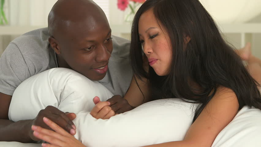 Asian couple playing and fucking on bed - XVIDEOSCOM