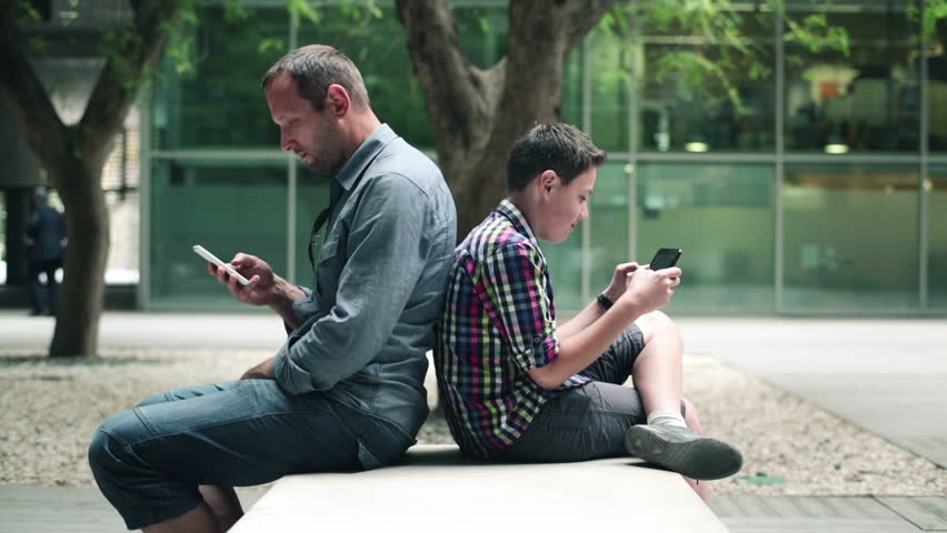 Father And Son With Tablet Computer And Smartphone In The ...
