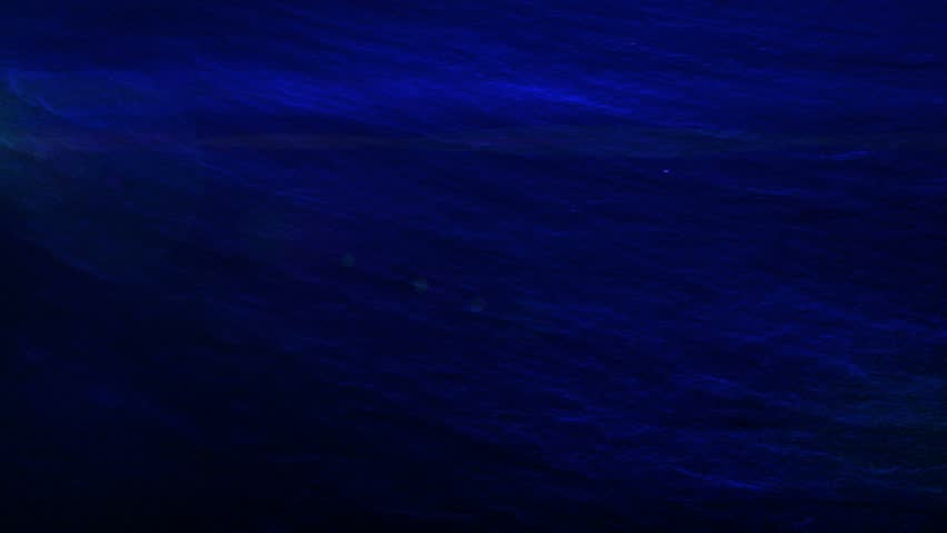 slow moving dark blue textured abstract background with